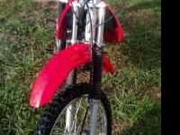 I have a 2003 Honda xr100 and two bike helmets for
