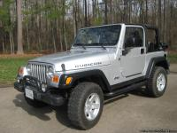 83,683 miles, Garage kept Silver with black soft top-