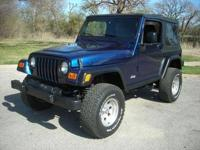 Lifted 2003 patriot Blue Jeep Wrangler. Was $13,995 now
