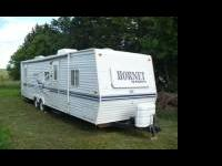 Excellent condition travel trailer that sleeps 8. Three