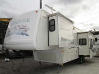 A 35' Fifth Wheel with 3 slide-outs, New Carpet, New