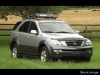 This 2003 Kia Sorento EX is complete with top-features