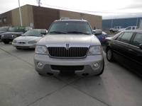 2003 Lincoln Navigator, Silver with matching black