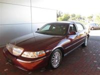 Racy yet refined, this 2003 Lincoln Town Car turns even