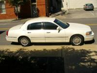 This classic 2003 Lincoln Signature Town Car is White