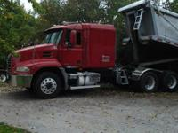 2003 Mack Vision And 2004 Hilbilt Dump Trailer. Sold as