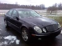 Sleek, black E500 Sports Model Mercedes with Gray