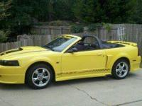 Yellow convertible w/ black top, black leather interior