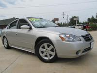 Options Included: Alloy Wheels, Sun Roof, CD, Rear