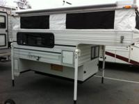 Like new pop up truck camper, loaded with options,