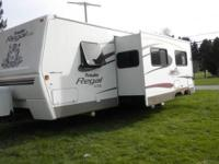 30 ft camper with slide out. Sleeps 8 comfy has sofa