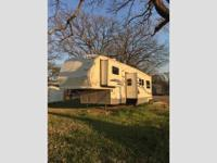 39' Sandpiper 5th wheel toy hauler. In great condition.