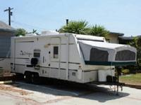 Rear Full Tent End Beds, Tub/Shower, Refrigerator,