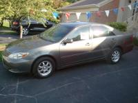 For Sale is a 2003 grey Toyota Camry LE in Great