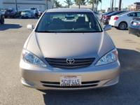 Options:  2003 Toyota Camry Le|Gold|Clean Carfax. Le