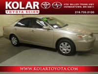 Camry LE and Desert Sand Mica. Join us at Kolar Toyota