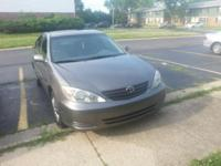 Dark gray 2003 Toyota Camry LE V6 with 199,439 initial