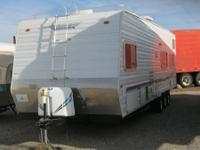 This 2003 Weekend Warrior 3000FS is a 31ft toy hauler.