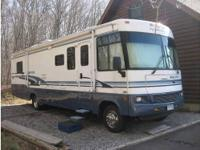 This Beautiful 2003 Winnebago Brave 36M Is Priced to