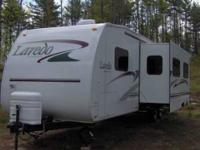 25' travel trailer with bunks, queen bed and table that