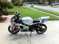 I am offering my Silver 2003 GSX-R 1000 motorbike which