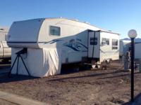 2004 5th Wheel Trailer, 12 ft slide, New awning,