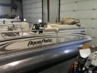 2004 Aqua Patio 2200 This boat is powered by a 70hp