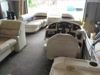 2004 Aqua Patio 220RE This boat is powered by a Yamaha