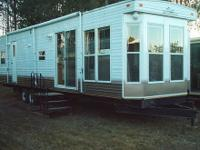 This model is a park trailer which has no 12 volt