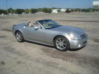 This is a 2004 Cadillac XLR Convertible with a 4.6L V8