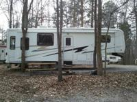 This is an 04' Carriage Compass Camper. It has a new