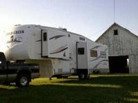 3 season camper.  Perfect for snow birds!  Queen bed,
