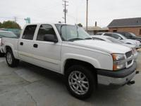 It's a LT Z71 four door with four wheel drive and