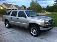 2004 Avalanche Z71 loaded. Power sunroof, seat, foot
