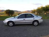 Silver Chevy Cavalier. Great gas mileage (about 33