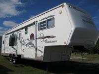 The 2004 Somerset fifth wheel is 36' and weighs 11464