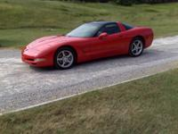 "Like new ""LITTLE RED CORVETTE"", black leather interior,"