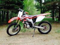 This is a 2004 CRF450R that has been converted and has