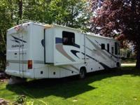 Like new motorhome with only 9400 miles. 12' living