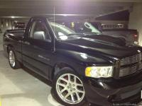 Hey everyone, here we have a black 2004 Dodge Ram