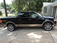 This is a 2004 2 wheel drive F-150 lariat w/ 91,700