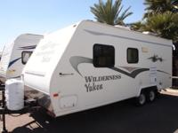 Is it a clean pre-owned Ultra-Lite travel trailer your
