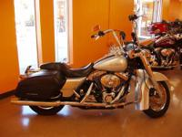This 2004 Road King is the top of the line model for