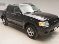 This 2004 Ford Explorer Sport Trac Crew Cab 2WD is