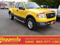 This 2004 Ford F-150 FX4 in Yellow features. service
