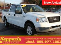 This 2004 Ford F-150 XLT in Oxford White features.
