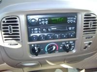 Options Included: AM/FM Radio, Air Conditioning, ABS