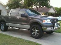 2004 Ford F150 Crew Cab Truck This 4X4 4-door truck is