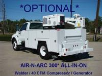 This 2004 Ford F650 Utility-Service Truck . The vehicle