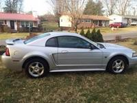 Silver 2004 Ford Mustang. V6. Automatic. NEW tires!